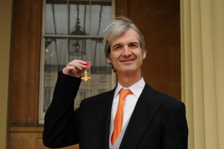 Andrew holds his OBE