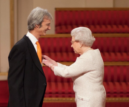 The Queen presents Andrew with his OBE